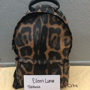 LE LV Palm Springs PM leopard backpack.